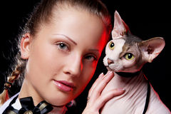 Woman with sphynx cat Royalty Free Stock Photos