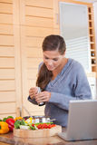 Woman spicing her meal Stock Photo