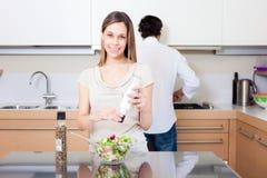 Woman spicing a salad Stock Photos