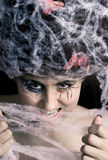 Woman with spider cobweb. Young woman with spider makeup and cobwebs in hair Royalty Free Stock Photo