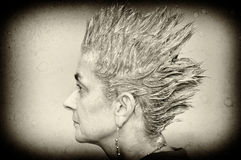 Woman with spiky hair Stock Photo