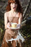 Woman spilled tea Stock Images