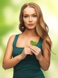 Woman with spinach leaves Royalty Free Stock Image