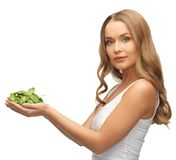 Woman with spinach leaves on palms Stock Photo
