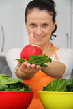 Woman with a spinach in a modern kitchen Stock Image