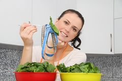 Woman with a spinach in a modern kitchen Stock Photos