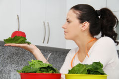 Woman with a spinach in a modern kitchen Royalty Free Stock Photos