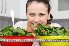 Woman with a spinach in a modern kitchen Royalty Free Stock Images