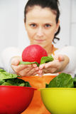 Woman with a spinach in a modern kitchen Royalty Free Stock Photography