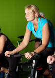 Woman in spinning class Stock Photo