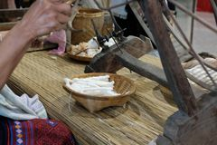 Free Woman Spinning Cotton Into Thread With Traditional Wheel Royalty Free Stock Photography - 126519847