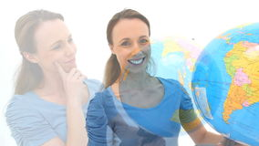 Woman spinning a globe stock footage