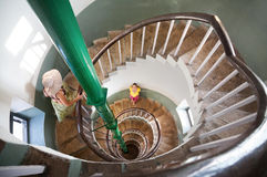 Woman on Spiral stairs Royalty Free Stock Photos