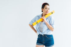 Woman with a spirit level Stock Images
