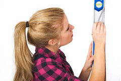 Woman with a spirit level Stock Photo