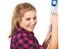 Woman with a spirit level Royalty Free Stock Photo