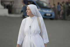 Woman and spirituality, catholic nun walking. A nun walking on the streets of Vatican City in Rome (Italy) / White habit Royalty Free Stock Photography