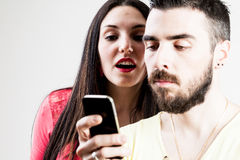 Woman spiying his man on his mobile Royalty Free Stock Image