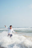 Woman in splash. Happy young woman in waves royalty free stock photos