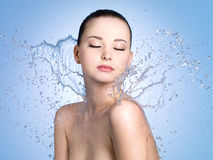 Woman in splashes of water Stock Photo