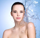 Woman with splashes of water Royalty Free Stock Photography