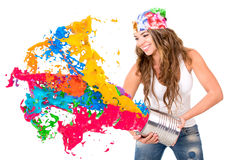 Woman splashing colorful paint Royalty Free Stock Image