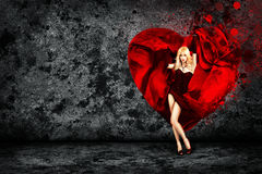 Woman with Splashing Heart on Dark Background Royalty Free Stock Images