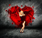 Woman with Splashing Heart on Dark Background Royalty Free Stock Image
