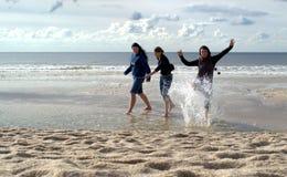 Woman splashing in sea Royalty Free Stock Images