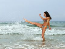 Woman splashing in the sea Stock Photos