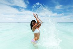 Woman splashing in sea Royalty Free Stock Images