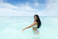 Woman splashing in sea Royalty Free Stock Image