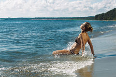 Woman splashing in sea Royalty Free Stock Photography