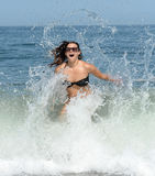 Woman splashing in sea Royalty Free Stock Photos