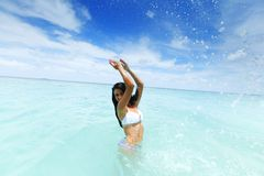 Woman splashing in sea Stock Photography
