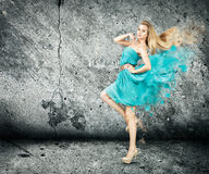 Woman in Splashing Turquoise Dress Stock Photos