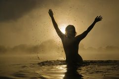 Woman splashing in water Stock Photo