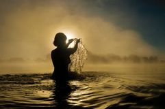 Woman splashing in water Stock Photography