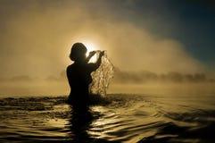 Woman splashing in water Stock Photography