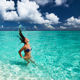 Woman splashing water with hair in the ocean Stock Image