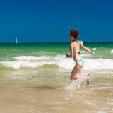Woman splashing water in the ocean Stock Images