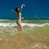 Woman splashing water in the ocean Royalty Free Stock Image
