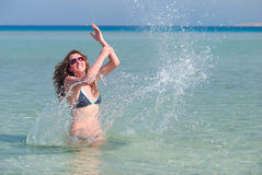 Woman is splasing in the sea Royalty Free Stock Images