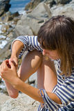 Woman with splinter in foot 1 Stock Image