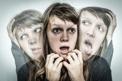 Woman with split personality suffers from schizophrenia Stock Photography