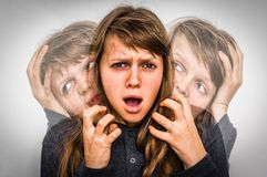 Woman with split personality suffers from schizophrenia stock photos