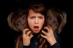 Woman with split personality suffers from schizophrenia Stock Image