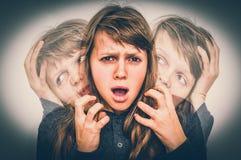 Woman with split personality suffers from schizophrenia. Schizophrenia disease concept - retro style stock photos