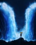Woman with splitting ocean Stock Image