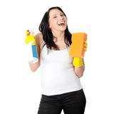 Woman with sponge and spray Stock Photo